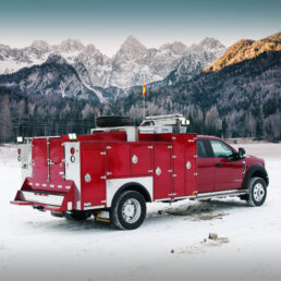 ORO 11M2 mechanic truck utility body in red, curb side with compartments closed on Ford F550 chassis and a Miller EnPak.