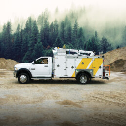 ORO 11M3 mechanic service truck body in white, street side closed on a Dodge Ram 5500 chassis with a Stellar® 4421 telescopic mechanic crane.