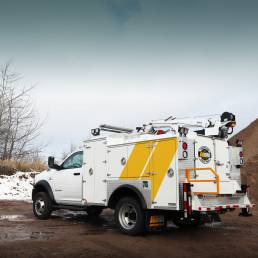 ORO 11M2 mechanic truck body in white, street side with compartments closed on Dodge Ram 5500 chassis and a Stellar 3315 telescopic crane.