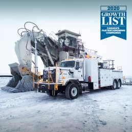 2020 Growth list of Canada's fastest growing companies logo with an ORO 20M8 mechanic service truck in an open pit in the arctic next to a Bucyrus RH400 excavator.